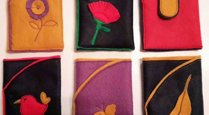 Felt phone pouch with pocket.